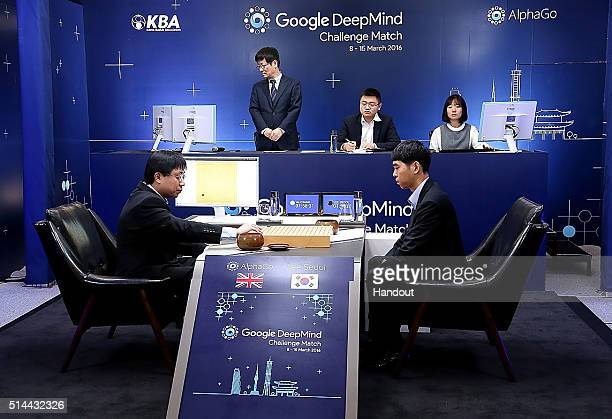 In this handout image provided by Google South Korean professional Go player Lee SeDol waits after putting the first stone against Google's...