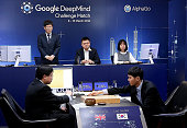 In this handout image provided by Google South Korean professional Go player Lee SeDol puts the first stone against Google's artificial intelligence...