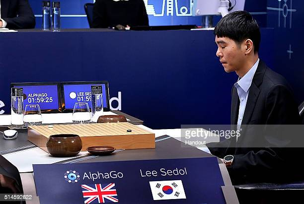 In this handout image provided by Google South Korean professional Go player Lee SeDol prepares for his second stone against Google's artificial...