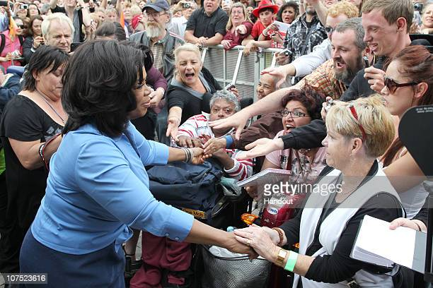 In this handout image provided by Harpo Productions Inc Oprah Winfrey greets fans at Federation Square on December 10 2010 in Melbourne Australia...