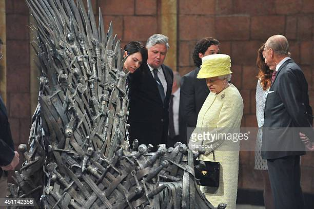 In this handout image provided by Harrison Photography Queen Elizabeth II meets cast members Lena Headey and Conleth Hill and views some of the props...