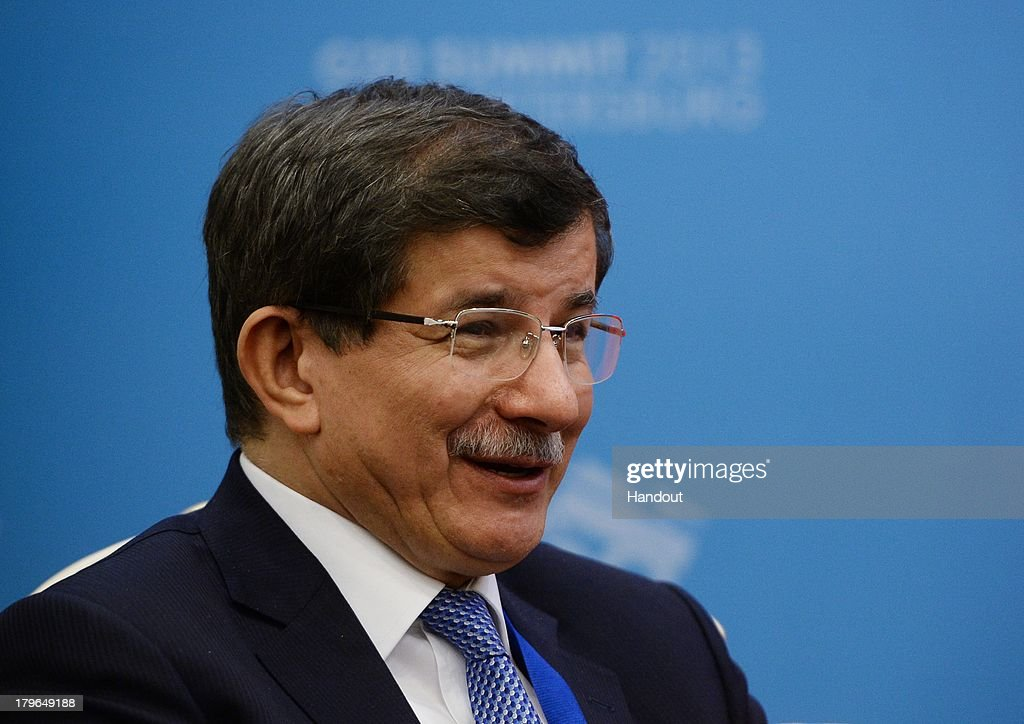 In this handout image provided by Host Photo Agency, <a gi-track='captionPersonalityLinkClicked' href=/galleries/search?phrase=Ahmet+Davutoglu&family=editorial&specificpeople=4940018 ng-click='$event.stopPropagation()'>Ahmet Davutoglu</a>, Minister of Foreign Affairs of the Republic of Turkey attends a meeting at the G20 Summit at the Constantine Palace at the G20 Summit on September 6, 2013 in St. Petersburg, Russia. Leaders of the G20 nations made progress on tightening up on multinational company tax avoidance, but remain divided over the Syrian conflict as they enter the final day of the Russian summit.