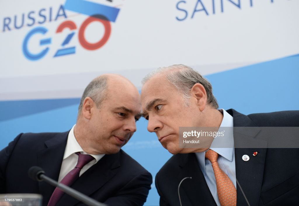 In this handout image provided by Host Photo Agency, Anton Siluanov, (L) Finance Minister of the Russian Federation, and Jose Angel Gurria, Secretary General of the Organization for Economic Co-operation and Development (OECD), attend the joint presentation of the report 'National strategies of the G20 member-countries for financial education.' at the G20 summit on September 5, 2013 in St. Petersburg, Russia. The G20 summit is expected to be dominated by the issue of military action in Syria while issues surrounding the global economy, including tax avoidance by multinationals, will also be discussed duing the two-day summit.