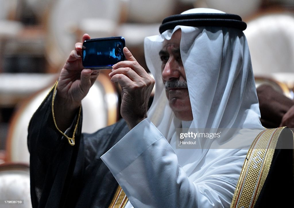 In this handout image provided by Host Photo Agency, Finance Minister of the Kingdom of Saudi Arabia, Ibrahim Abdulaziz Al-Assaf is seen taking a photo at the musical fountain show for the G20 Summit participants by the Grand Cascade on September 5, 2013 in St. Petersburg, Russia. The G20 summit is expected to be dominated by the issue of military action in Syria while issues surrounding the global economy, including tax avoidance by multinationals, will also be discussed during the two-day summit.
