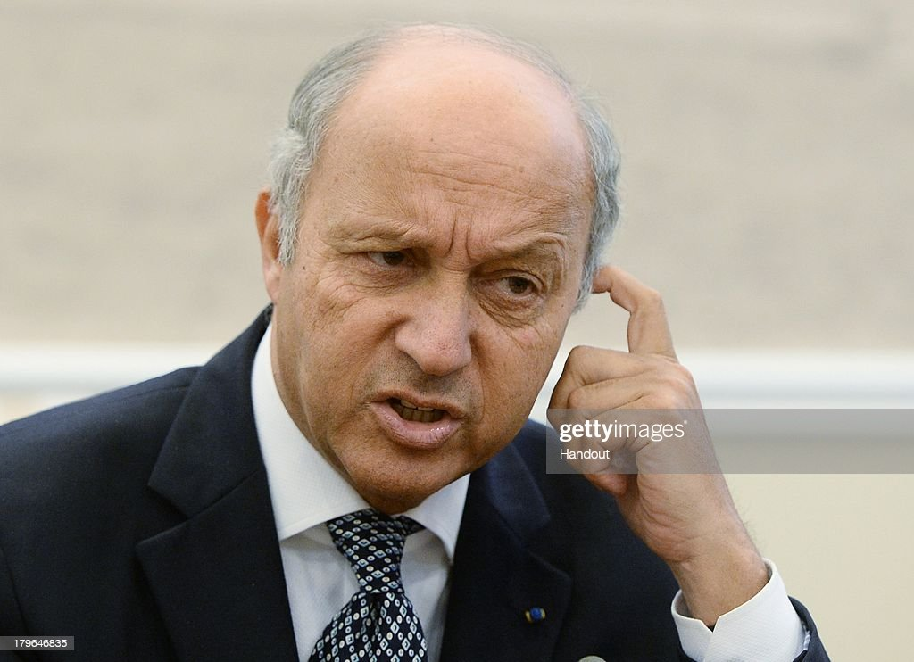 In this handout image provided by Host Photo Agency, French Foreign Minister <a gi-track='captionPersonalityLinkClicked' href=/galleries/search?phrase=Laurent+Fabius&family=editorial&specificpeople=540660 ng-click='$event.stopPropagation()'>Laurent Fabius</a> attends a meeting with Russian Foreign Minster Sergei Lavrov in Constantine Palace at the G20 Summit on September 6, 2013 in St. Petersburg, Russia. Leaders of the G20 nations made progress on tightening up on multinational company tax avoidance, but remain divided over the Syrian conflict as they enter the final day of the Russian summit.