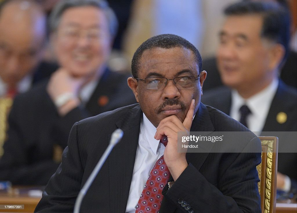 In this handout image provided by Host Photo Agency, <a gi-track='captionPersonalityLinkClicked' href=/galleries/search?phrase=Hailemariam+Desalegn&family=editorial&specificpeople=7752700 ng-click='$event.stopPropagation()'>Hailemariam Desalegn</a>, Prime Minister of the Federal Democratic Republic of Ethiopia, Chairman of the African Union attends a meeting with Business 20 and Labour 20 representatives at the G20 Summit on September 6, 2013 in St. Petersburg, Russia. Leaders of the G20 nations made progress on tightening up on multinational company tax avoidance, but remain divided over the Syrian conflict as they enter the final day of the Russian summit.