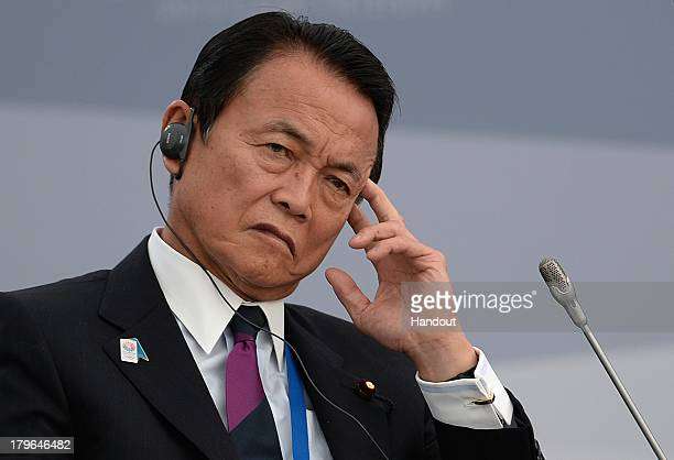 In this handout image provided by Host Photo Agency Japanese Finance Minister Taro Aso attends a meeting with Business 20 and Labour 20...