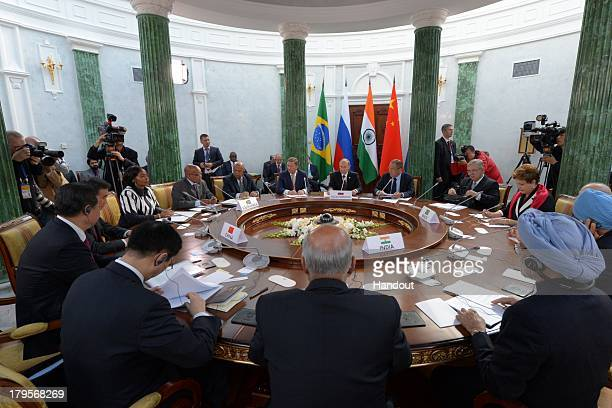 In this handout image provided by Host Photo Agency leaders sit at a table for the BRICS summit during the G20 summit on September 5 2013 in St...