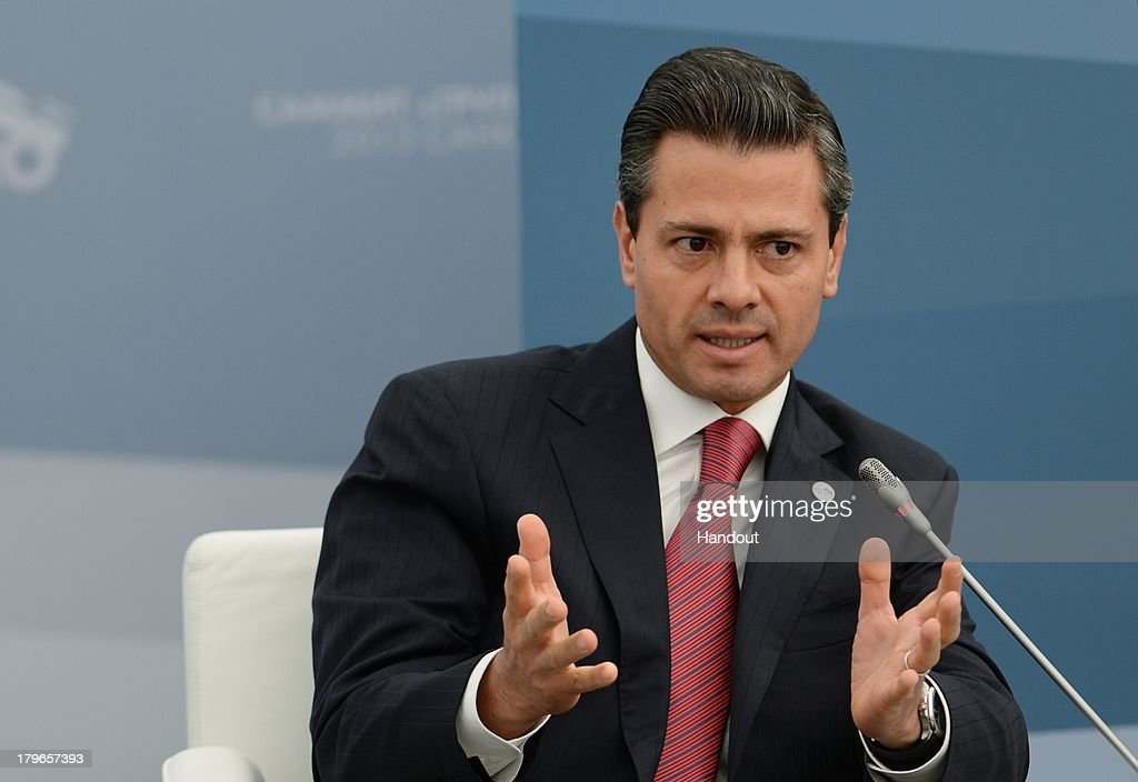 In this handout image provided by Host Photo Agency, President of Mexico Enrique Pena Nieto attends a meeting with Business 20 and Labour 20 representatives at the G20 Summit on September 6, 2013 in St. Petersburg, Russia. Leaders of the G20 nations made progress on tightening up on multinational company tax avoidance, but remain divided over the Syrian conflict as they enter the final day of the Russian summit.