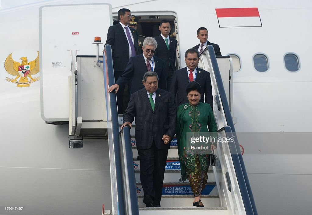 In this handout image provided by Host Photo Agency, President of the Republic of Indonesia <a gi-track='captionPersonalityLinkClicked' href=/galleries/search?phrase=Susilo+Bambang+Yudhoyono&family=editorial&specificpeople=206513 ng-click='$event.stopPropagation()'>Susilo Bambang Yudhoyono</a>, (Front, L) and his wife Kristiani Herawati Yudhoyono arrive at the G20 summit on September 5, 2013 in St. Petersburg, Russia. The G20 summit is expected to be dominated by the issue of military action in Syria while issues surrounding the global economy, including tax avoidance by multinationals, will also be discussed duing the two-day summit.