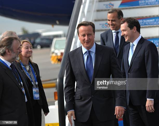 In this handout image provided by Host Photo Agency Prime Minister of the Britain David Cameron arrives for the G20 summit on September 5 2013 in St...