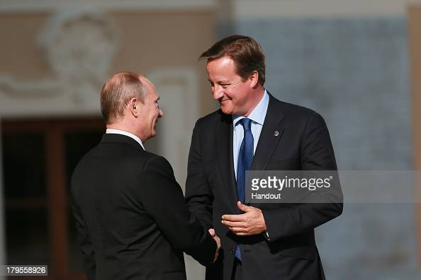 In this handout image provided by Host Photo Agency Russian President Vladimir Putin and Prime Minister of United Kingdom of Great Britain and...