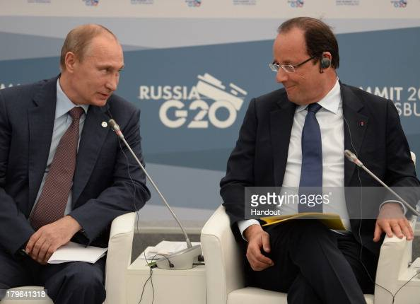 In this handout image provided by Host Photo Agency Russian President Vladimir Putin and French President Francois Hollande attend a meeting with...