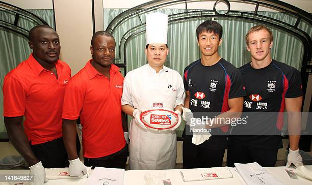In this handout image provided by HSBC Hong Kong players Salom Yiu kamshing Alex McQueen and Kenyan players Collins Injera and Benedict Nyambu go...