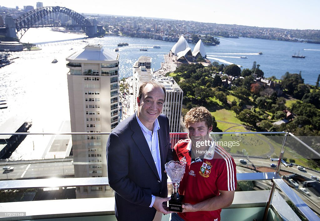In this handout image provided by HSBC, Leigh Halfpenny is awarded the British & Irish Lions HSBC player of the Series Award by Giles Morgan, Global Head of Sponsorship & Events for HSBC, the Principal Partner of the Tour, on July 7, 2013 in Sydney, Australia. Halfpenny scored a record 21 points in the Third Test to lead the Lions to victory and 49 points on the Tour, another record points tally for a Lions Tour.