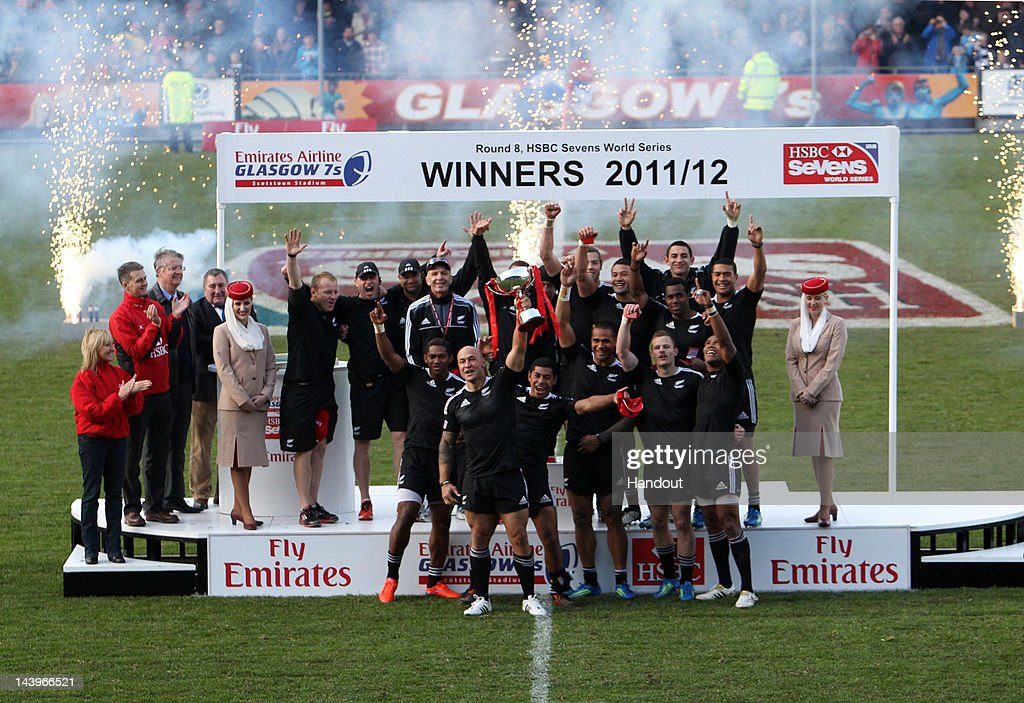In this handout image provided by HSBC, New Zealand celebrate with the trophy after the HSBC Sevens World Series match for the Final Cup match between England and New Zealand at Scotstoun Stadium in Glasgow, Scotland.