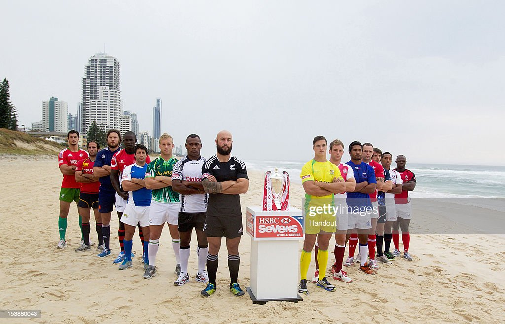 In this handout image provided by HSBC, the 15 Rugby Sevens team captains pose on the beach with the tournament trophy ahead of round one of the IRB HSBC Sevens World Series 2012/13, on October 10, 2012 on the Gold Coast, Australia. The tournament commences on October 13, 2012 at Skilled Park.