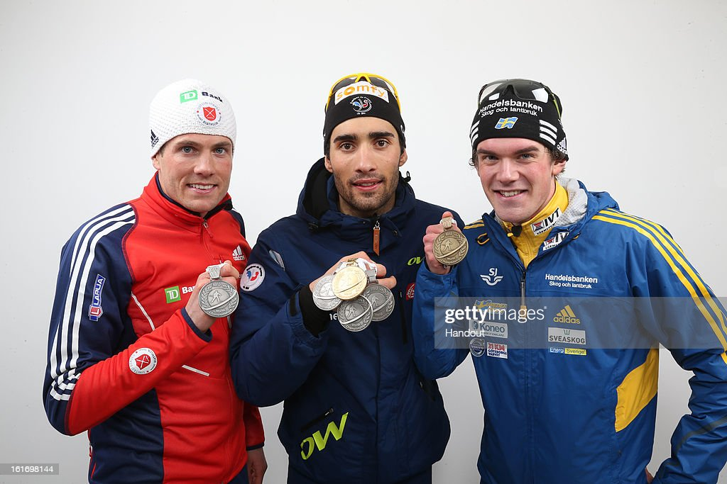 In this handout image provided by IBU, (L-R) medal winners, Tim Burke of USA, Martin Fourcade of France and Fredrik Lindstroem of Sweden after the IBU Biathlon World Championships - Men's Distance, 20km Mens Individual on February 14, 2013 in Nove Mesto na Morave, Czech Republic.