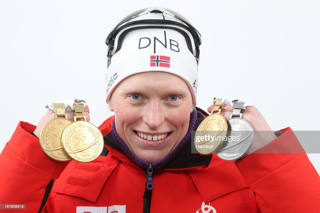 In this handout image provided by IBU, Tora Berger of Norway poses holding her medals including her gold medal after taking first place in the IBU Biathlon World Championships Women's 15km Individual on February 13, 2013 in Nove Mesto na Morave, Czech Republic.