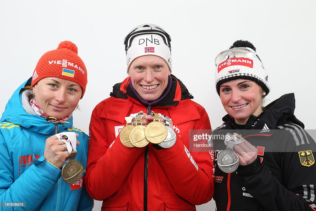 In this handout image provided by IBU, (L-R) Valj Semerenko of Ukraine (third place), <a gi-track='captionPersonalityLinkClicked' href=/galleries/search?phrase=Tora+Berger&family=editorial&specificpeople=812729 ng-click='$event.stopPropagation()'>Tora Berger</a> of Norway (first place) and <a gi-track='captionPersonalityLinkClicked' href=/galleries/search?phrase=Andrea+Henkel&family=editorial&specificpeople=233764 ng-click='$event.stopPropagation()'>Andrea Henkel</a> of Germany (second place) pose with their medals won in the IBU Biathlon World Championships Women's 15km Individual on February 13, 2013 in Nove Mesto na Morave, Czech Republic.