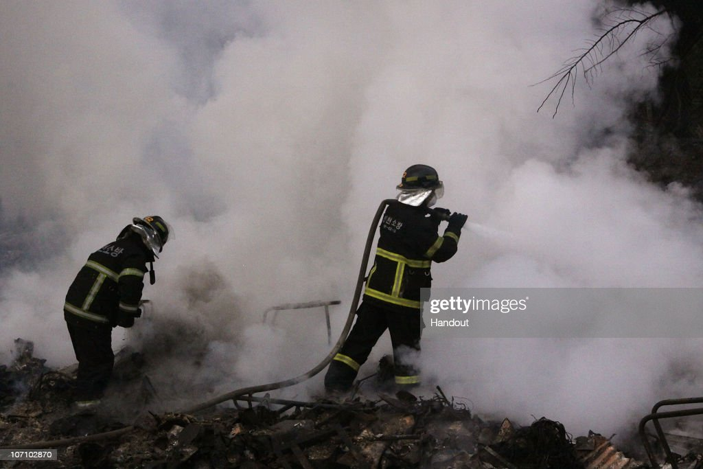 In this handout image provided by Incheon Fire and Safety Management Department firefighters are seen extinguishing a fire after the damage caused by...