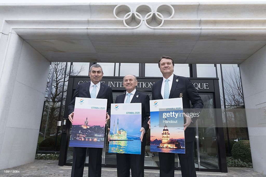 In this handout image provided by Istanbul 2020, IOC member and President of the Turkish NOC, Professor Ugur Erdener, Mayor of Istanbul Kadir Topbas and Istanbul 2020 bid leader, Hasan Arat pose as they submit its Candidature File to the International Olympic Committee outside the IOC headquarters on January 7, 2013 in Lausanne, Switzerland.