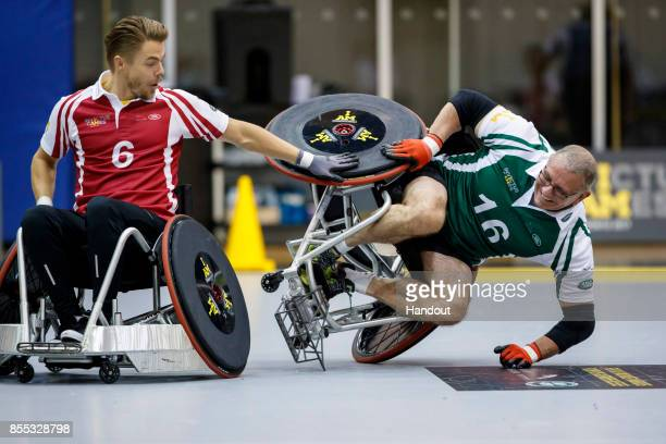 In this handout image provided by Jaguar Land Rover Derek Hough and Robert Irvine take part in the Jaguar Land Rover celebrity wheelchair rugby...