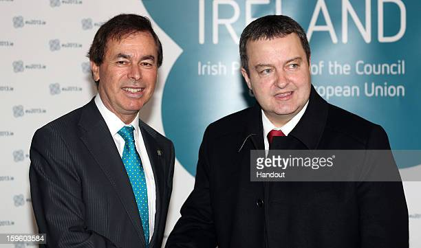 In this handout image provided by Justin MacInnes Alan Shatter TD Minister for Justice Equality and Defence with Ivica Dacic Prime Minister of Serbia...