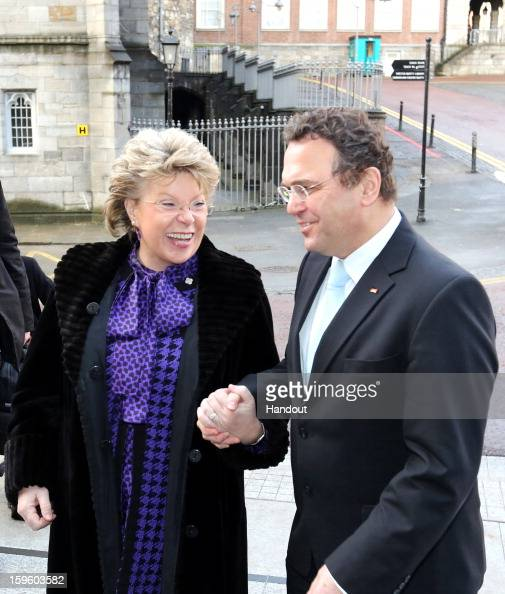 In this handout image provided by Justin MacInnes HansPeter Friedrich German Interior Minister with Viviane Reding Vice President of the European...