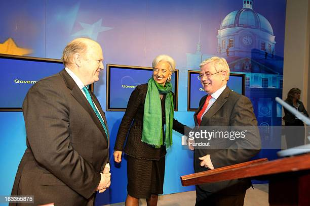 In this handout image provided by Justin MacInnes International Monetary Fund Managing Director Christine Lagarde with Minister for Finance Michael...