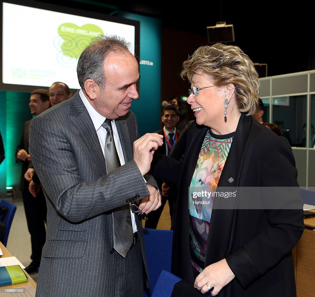 In this handout image provided by Justin MacInnes, Viviane Reding, Vice President of the European Commission (R) talks with Loucas Louca, Minister for Justice and Public Order, Cyprus, at the Informal Justice and Home Affairs Council meeting in Dublin Castle, Dublin, Ireland on January 18, 2013, as part of Ireland's hosting of the EU Presidency.