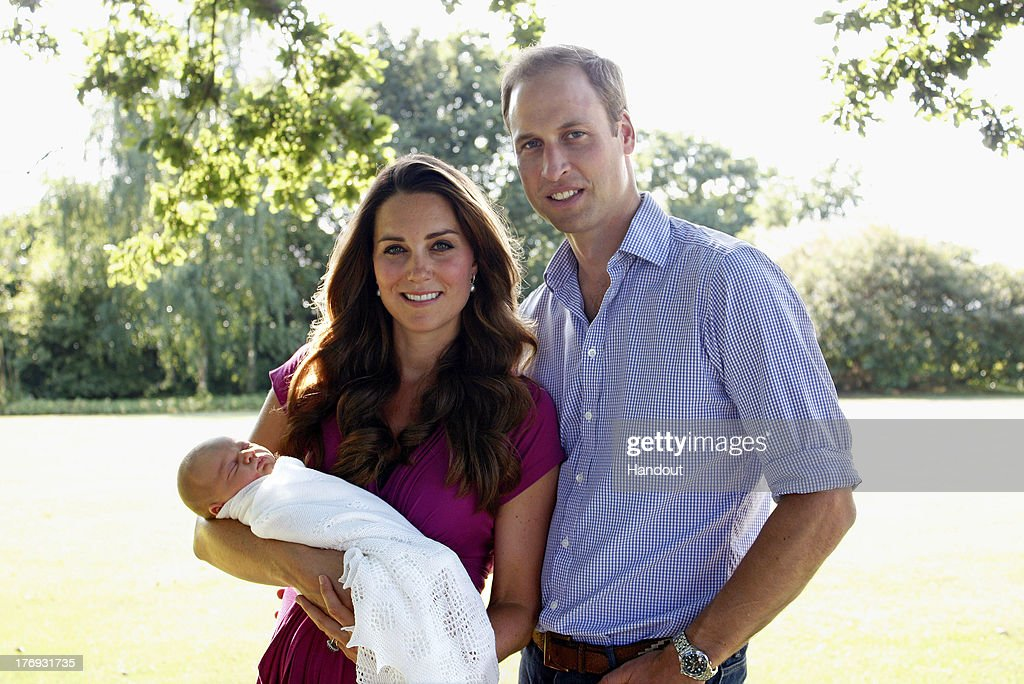 In this handout image provided by Kensington Palace, Catherine, Duchess of Cambridge and <a gi-track='captionPersonalityLinkClicked' href=/galleries/search?phrase=Prince+William&family=editorial&specificpeople=178205 ng-click='$event.stopPropagation()'>Prince William</a>, Duke of Cambridge pose for a photograph with their son, Prince George Alexander Louis of Cambridge in the garden of the Middleton family home in August 2013 in Bucklebury, Berkshire.