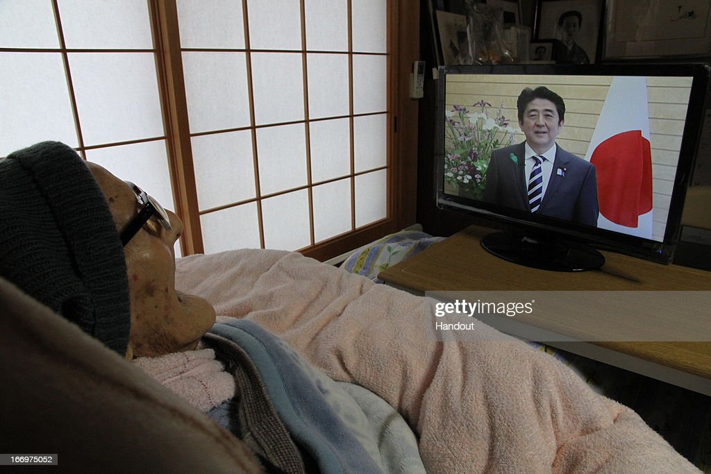 In this handout image provided by Kyotango City government, the world's oldest person Jiroemon Kimura watches a video message from Japanese Prime Minister Shinzo Abe as he celebrates his 116th birthday at his home on April 19, 2013 in Kyotango, Kyoto, Japan. Kimura was born in 1897, has 7 children, 14 grandchildren, 25 great-grandchildren and 14 great-great-grandchildren.