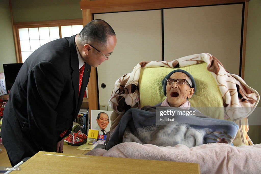 In this handout image provided by Kyotango City government, the world's oldest person Jiroemon Kimura is celebrated by Kyotango City Mayor Yasushi Nakayama as he celebrates his 116th birthday at his home on April 19, 2013 in Kyotango, Kyoto, Japan. Kimura was born in 1897, has 7 children, 14 grandchildren, 25 great-grandchildren and 14 great-great-grandchildren.