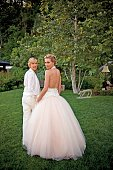 In this handout image provided by Lara Porzak Photography Comedian Ellen DeGeneres and actress Portia de Rossi pose for photos celebrating their...