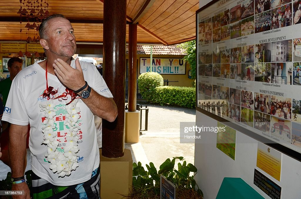 In this handout image provided by Laureus, Sir <a gi-track='captionPersonalityLinkClicked' href=/galleries/search?phrase=Ian+Botham&family=editorial&specificpeople=207145 ng-click='$event.stopPropagation()'>Ian Botham</a> looks at a display at the foundation for goodness after finishing the eighth and final day of Beefy's Big Sri Lanka walk 2013 walk on November 8, 2013 from Galle to Seenigama, Sri Lanka.