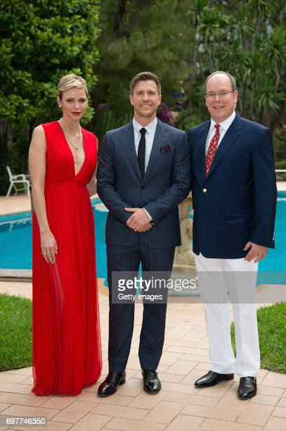 In this handout image provided by Le Palais Princie Princess Charlene of Monaco a guest and Prince Albert II of Monaco attend the 'The Bold and The...