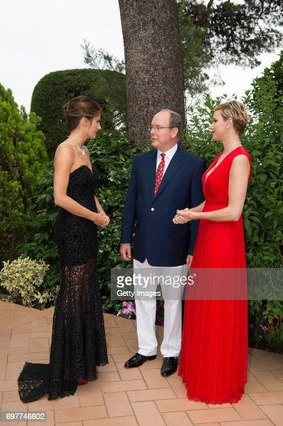 In this handout image provided by Le Palais Princier a guest Prince Albert II of Monaco and Princess Charlene of Monaco attend the 'The Bold and The...