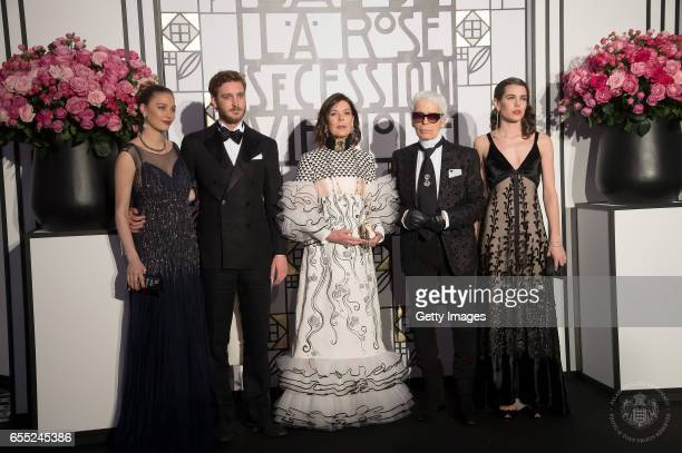 In this handout image provided by Le Palais Princier Beatrice BorromeoPierre Casiraghi Princess Caroline of Hanover Karl Lagerfeld and Charlotte...
