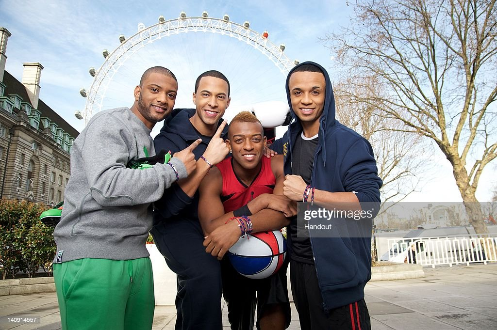 In this handout image provided by Links of London (L-R) Jonathan 'JB' Gill, <a gi-track='captionPersonalityLinkClicked' href=/galleries/search?phrase=Marvin+Humes&family=editorial&specificpeople=2887070 ng-click='$event.stopPropagation()'>Marvin Humes</a>, <a gi-track='captionPersonalityLinkClicked' href=/galleries/search?phrase=Oritse+Williams&family=editorial&specificpeople=5739700 ng-click='$event.stopPropagation()'>Oritse Williams</a> and <a gi-track='captionPersonalityLinkClicked' href=/galleries/search?phrase=Aston+Merrygold&family=editorial&specificpeople=5739699 ng-click='$event.stopPropagation()'>Aston Merrygold</a> of the band JLS pose for pictures wearing their Links of London Team GB Bands on March 8, 2012 in London, England. The Links of London Team GB band is on sale from www.linksoflondon.com