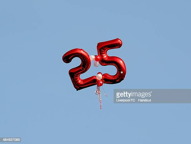In this handout image provided by Liverpool FC a 25th balloon floats out of Anfield during the 25th Hillsborough Anniversary Memorial Service at...
