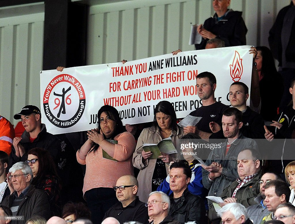 In this handout image provided by Liverpool FC, A banner acknowledging Anne Williams, mother of 15 year old victim Kevin Williams, is displayed during the 24th Hillsborough Anniversary Memorial Service at Anfield on April 15, 2013 in Liverpool, England. Thousands of fans, friends and relatives took part in the service at Liverpool's Anfield Stadium to mark the 24th anniversary of the Hillsborough disaster. A total of 96 Liverpool supporters lost their lives during a crush at an FA Cup semi final against Nottingham Forest at the Hillsborough football ground in Sheffield, South Yorkshire in 1989.
