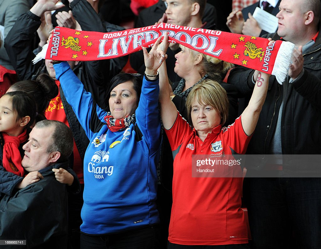 In this handout image provided by Liverpool FC, Everton and Liverpool supporters hold team scarves aloft during the 24th Hillsborough Anniversary Memorial Service at Anfield on April 15, 2013 in Liverpool, England. Thousands of fans, friends and relatives took part in the service at Liverpool's Anfield Stadium to mark the 24th anniversary of the Hillsborough disaster. A total of 96 Liverpool supporters lost their lives during a crush at an FA Cup semi final against Nottingham Forest at the Hillsborough football ground in Sheffield, South Yorkshire in 1989.