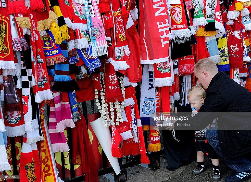 In this handout image provided by Liverpool FC, fans gather at the Hillsborough memorial during the memorial service marking the 25th anniversary of the Hillsborough Disaster, at Anfield Stadium on April 15, 2014 in Liverpool, England. Thousands of fans, friends and relatives are attending the service at Liverpool's Anfield Stadium to mark the 25th anniversary of the Hillsborough tragedy. 96 Liverpool supporters lost their lives during a crush at an FA Cup semi final against Nottingham Forest at the Hillsborough football ground in Sheffield, South Yorkshire in 1989.