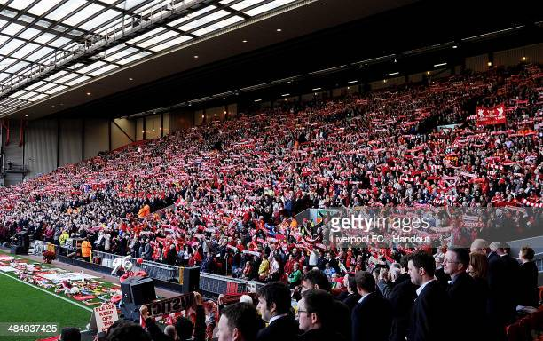 In this handout image provided by Liverpool FC fans of Liverpool hold scarves aloft as they stand on the Kop during the 25th Hillsborough Anniversary...
