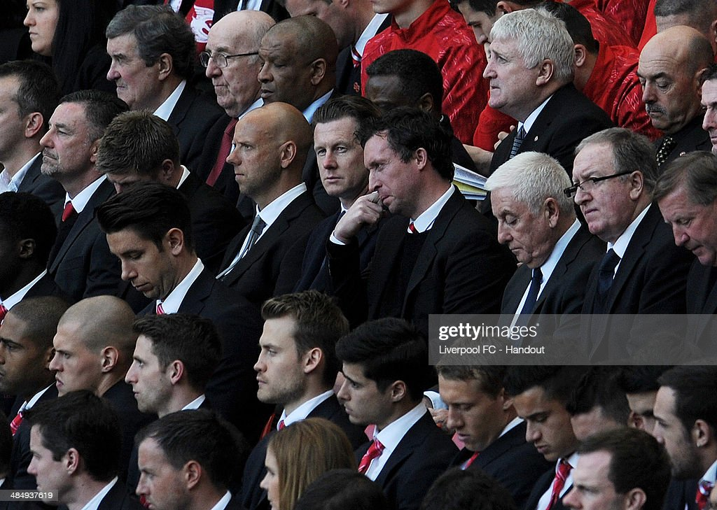In this handout image provided by Liverpool FC, former Liverpool players Robbie Fowler (C) and Steve McManaman (centre left) sit next to former manager Roy Evans (centre right) during the 25th Hillsborough Anniversary Memorial Service at Anfield on April 15, 2014 in Liverpool, England.