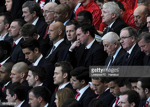 In this handout image provided by Liverpool FC former Liverpool players Robbie Fowler and Steve McManaman sit next to former manager Roy Evans during...