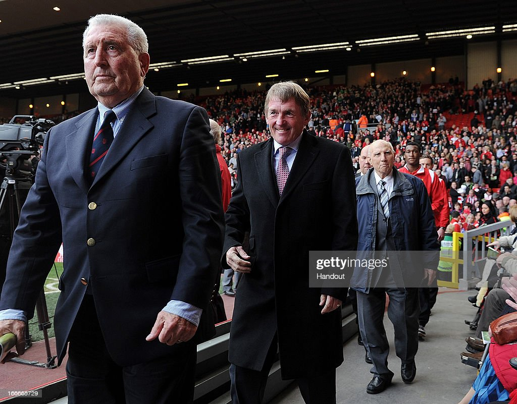 In this handout image provided by Liverpool FC, former player and manager <a gi-track='captionPersonalityLinkClicked' href=/galleries/search?phrase=Kenny+Dalglish&family=editorial&specificpeople=221580 ng-click='$event.stopPropagation()'>Kenny Dalglish</a> (C) and former captain and coach Ronnie Moran (R) attend the 24th Hillsborough Anniversary Memorial Service at Anfield on April 15, 2013 in Liverpool, England. Thousands of fans, friends and relatives took part in the service at Liverpool's Anfield Stadium to mark the 24th anniversary of the Hillsborough disaster. A total of 96 Liverpool supporters lost their lives during a crush at an FA Cup semi final against Nottingham Forest at the Hillsborough football ground in Sheffield, South Yorkshire in 1989.