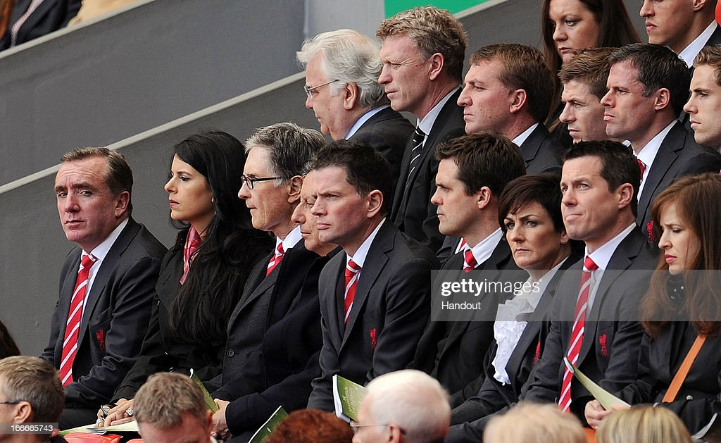 In this handout image provided by Liverpool FC, guests including (Back Row L-R) Chairman <a gi-track='captionPersonalityLinkClicked' href=/galleries/search?phrase=Bill+Kenwright&family=editorial&specificpeople=550384 ng-click='$event.stopPropagation()'>Bill Kenwright</a> of Everton, manager <a gi-track='captionPersonalityLinkClicked' href=/galleries/search?phrase=David+Moyes&family=editorial&specificpeople=215482 ng-click='$event.stopPropagation()'>David Moyes</a> of Everton, manager Brendan Rogers of Liverpool, Steven Gerrard, <a gi-track='captionPersonalityLinkClicked' href=/galleries/search?phrase=Jamie+Carragher&family=editorial&specificpeople=206485 ng-click='$event.stopPropagation()'>Jamie Carragher</a> and <a gi-track='captionPersonalityLinkClicked' href=/galleries/search?phrase=Jordan+Henderson+-+Soccer+Player&family=editorial&specificpeople=4940390 ng-click='$event.stopPropagation()'>Jordan Henderson</a>, (Front Row L- 4th L) Liverpool managing director Ian Ayre, Linda Pizzuti, principal owner John W Henry and chairman Tom Werner attend the 24th Hillsborough Anniversary Memorial Service at Anfield on April 15, 2013 in Liverpool, England. Thousands of fans, friends and relatives took part in the service at Liverpool's Anfield Stadium to mark the 24th anniversary of the Hillsborough disaster. A total of 96 Liverpool supporters lost their lives during a crush at an FA Cup semi final against Nottingham Forest at the Hillsborough football ground in Sheffield, South Yorkshire in 1989.