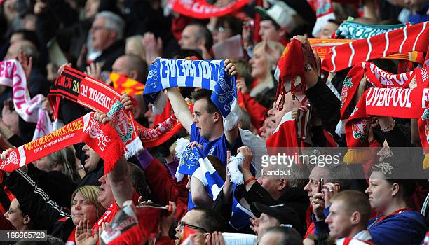 In this handout image provided by Liverpool FC members of the congregation hold aloft Everton and Liverpool scarves during the 24th Hillsborough...